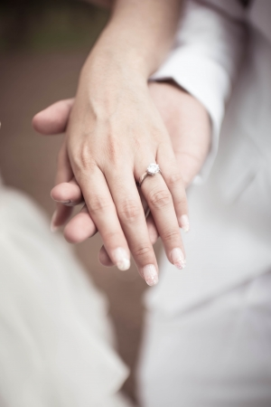 wedding theme, holding hands with love Stock Photo
