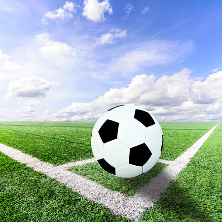Ball on Corner of a soccer field and blue sky photo