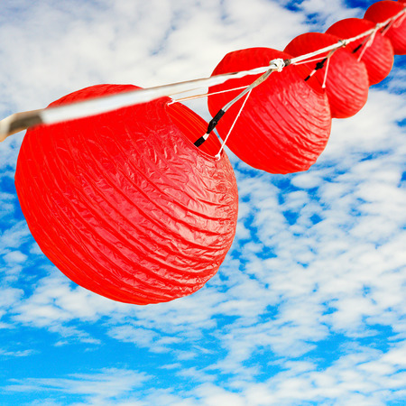 red lantern with blue sky with clipping path photo