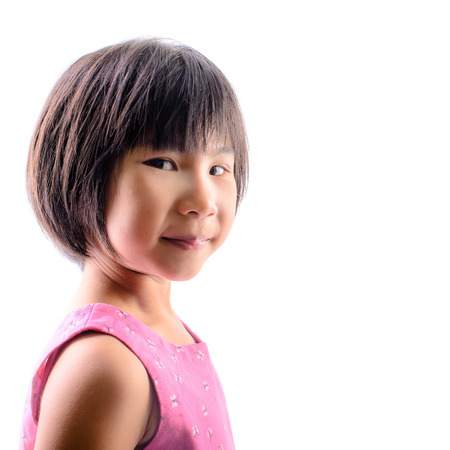 Cute Asian girl look at camera, isolated on white. photo