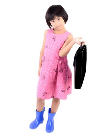 Little girl in pink dress with briefcase isolated on white background photo