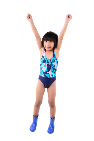 Cute smiling little girl in swimsuit isolated on white background photo