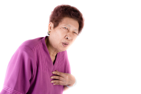 Woman with heart pain isolated on white background photo