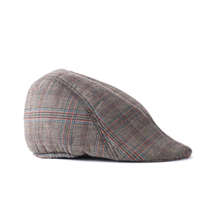 Flat cap in grey and brown tweed isolated  photo