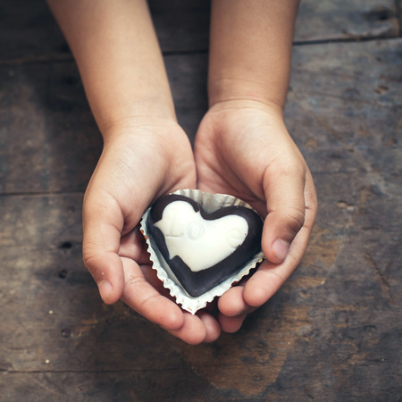 Love note on black and white chocolate in kid photo