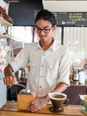 Barista make coffee grinder. photo