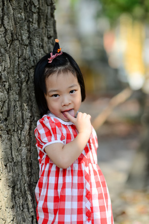 Shy Asian girl in the park outdoor. photo