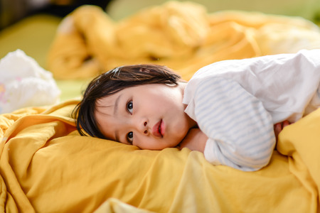 Child in bed photo