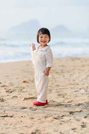 Happy Asian girl enjoy at the beach. photo