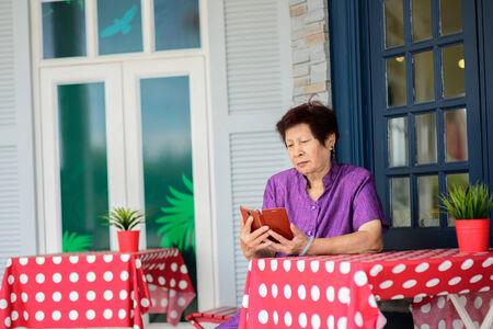 Happy elderly woman selfie herself with her smart phone