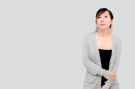 Chinese Asian woman Model wearing grey cardigan isolated. photo