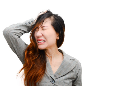 going crazy: Stress. Woman stressed is going crazy pulling her hair in frustration. Close-up of Smart businesswoman on white.