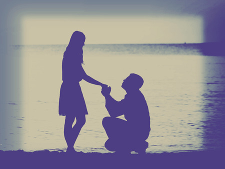 Man knees ask woman to marry,intragram filter. photo