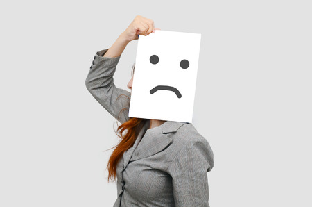 Business woman with white board and unhappy face. photo