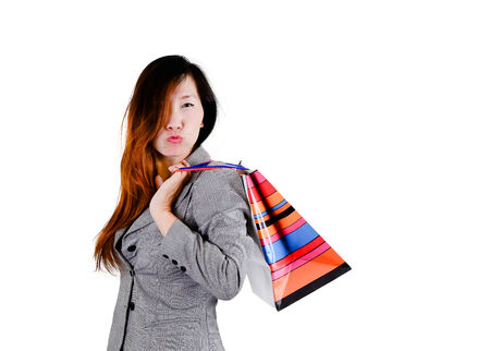 Portrait of happy smiling woman hold shopping bag. photo