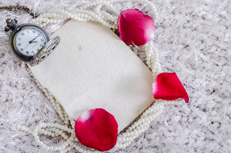 Red rose, pearl, pocket watch and  mulberry paper notebook, vintage style process. photo