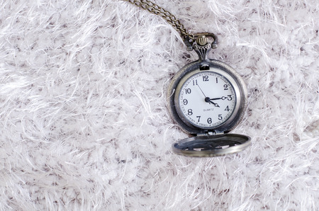 pocket watch: Old pocket watch lying on layers of vintage lace