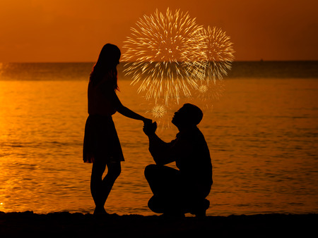 marry: Man knees ask woman to marry with firework.