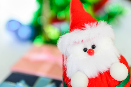 dept: Close up Santa doll with bokeh background, dept of field. Stock Photo