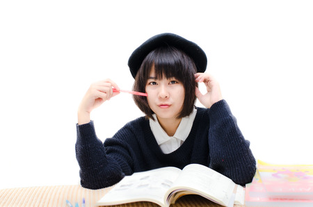 Asian teenager reading books. photo