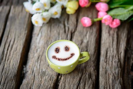 happy coffee on wooden background