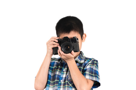 handsome boy with an old camera isolated on white. photo