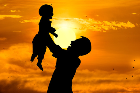 day care: Father holding his child with rising sun, Fathers day concep