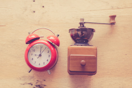 nostalgic: Nostalgic times with coffee grinder and old clock