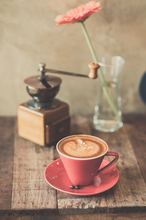 Nostalgic times with coffee grinder and old clock photo