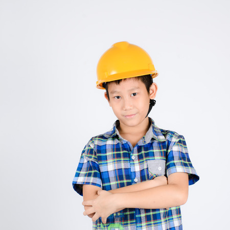 Kid dressed like worker with his arms crossed photo