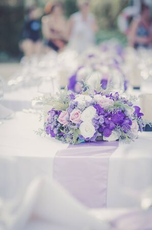fabrick: Romantic vintage White and purple roses bouquet on set up dinner.