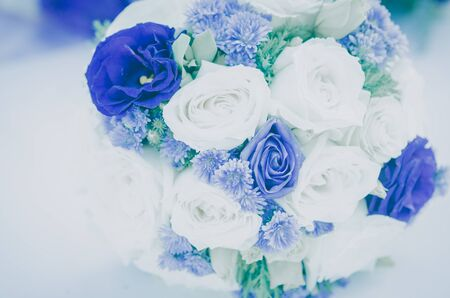 fabrick: Romantic vintage White and purple roses bouquet on table. Stock Photo