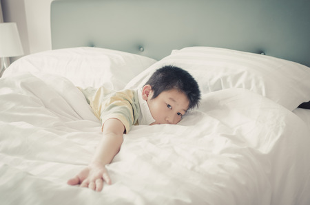 Close up Asain boy relaxing on bed. Stock Photo