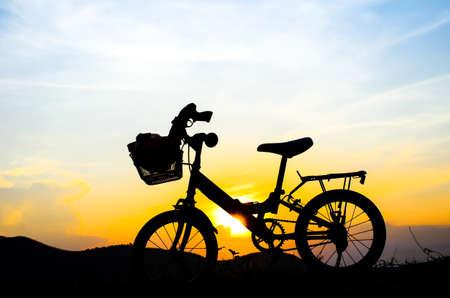 sun set: Bicycle silhouette with sun set.