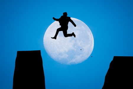 man in the moon: silhouette Man Jumping in sun rise with big moon