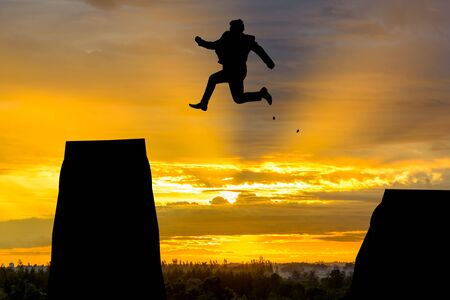 silhouette Man Jumping in sun rise. photo