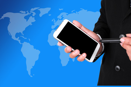 pocket pc: Closeup of a businessmans hands with a pocket pc, world map background.