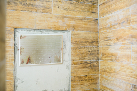 undone: Unfinished bathroom.