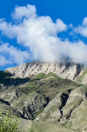 kashmir: Cloud covering top of mountain, Kashmir, India. Stock Photo