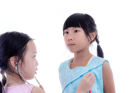 school nurse: Two pretty little girls playing doctor