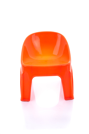 patio chair: Orange plastic chair on isolated white background with reflection.