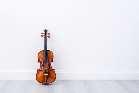 Classical cello on white wall background