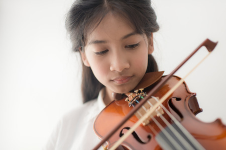 dof: close up Asian teenager playing violin, depth of field.
