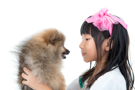 Cute Asian child with her happy doggy Stock Photo