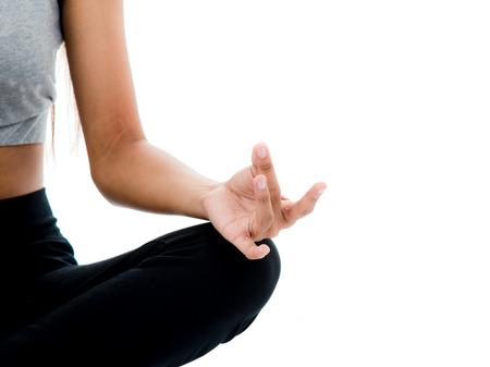 centrality: Healthy slim girl meditating on white.
