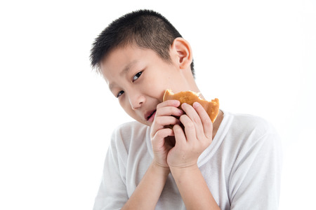 dough nut: Boy eating dough nut Isolate on white background Stock Photo