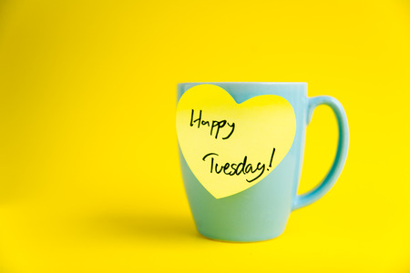 tuesday: Happy Tuesday message on blue pastel mug.