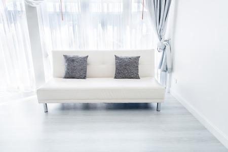 white sofa: white sofa in room