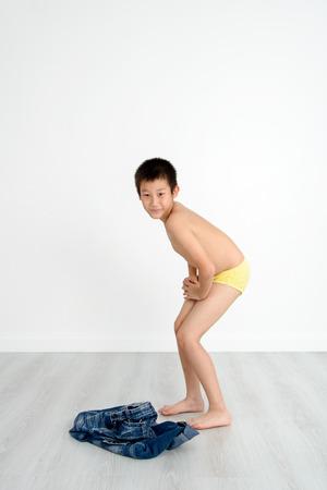 boy underwear: Asian shy boy with underwear on gray background.