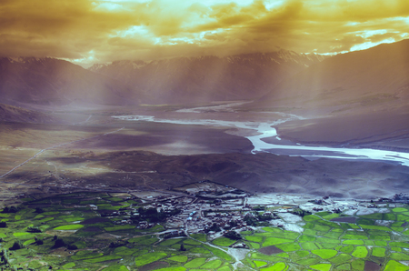 aerial view of ladakh landscape, green valley field on cloudy and raylight. Stock Photo